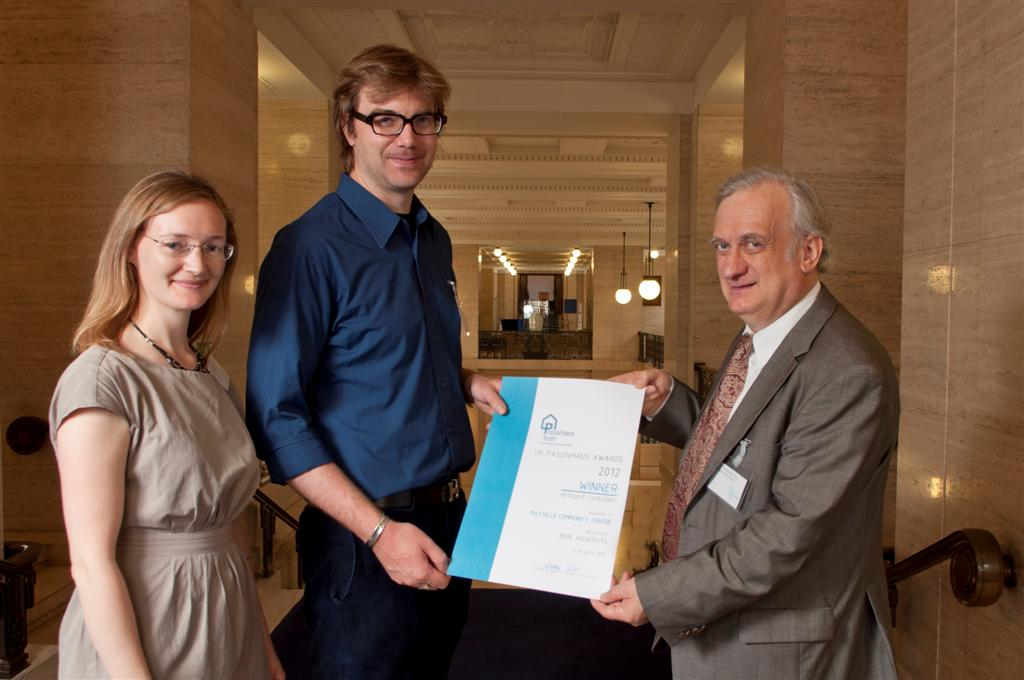 Sarah Lewis, Christian Senkpiel accepting Mayville certificate on behalf of Bere Architects from Dr Wolfgang Feist.jpg